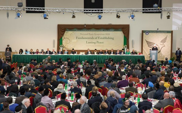 Hazrat Mirza Masroor Ahmad Khalifatul Masih Vaa addressing the 2018 Peace Symposium