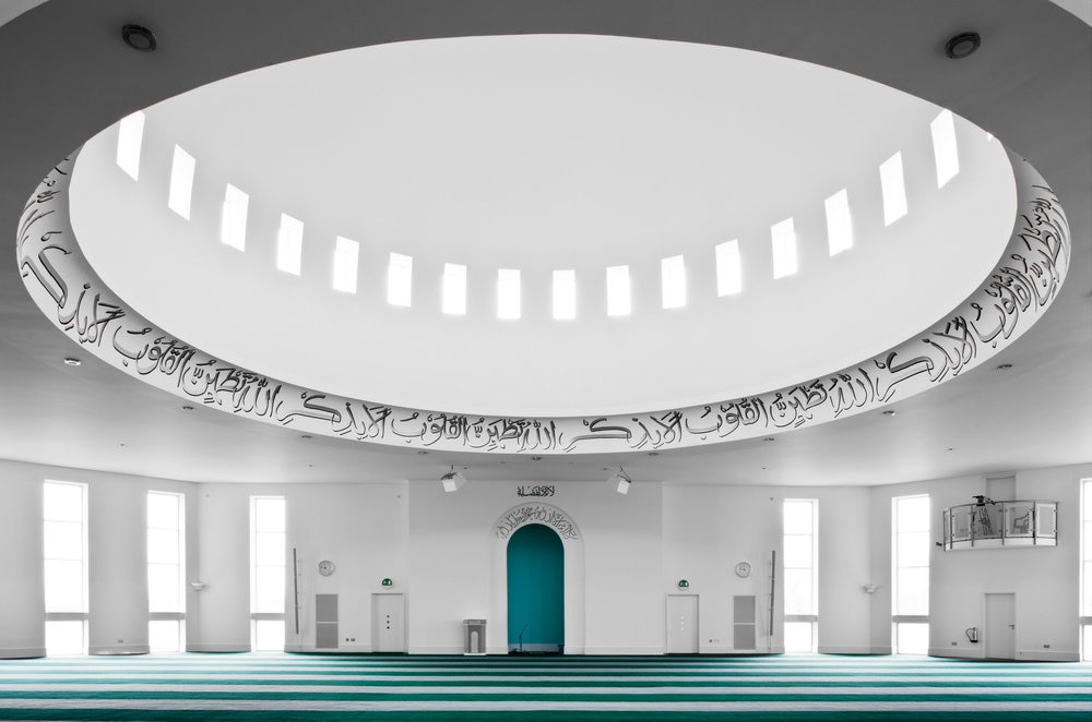 rsz_the_interior_of_the_baitul_futuh_mosque_is_restrained_and_simple_with_a_large_central_dome_and_fl_oor-toceiling_windows.jpg